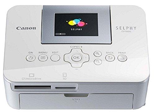 Canon Selphy CP1000 Fotodrucker 10x15 cm (mobiler Drucker, USB, 300x300 dpi, optionaler Akku, Farbdisplay, Direktdruck von kompatiblen Kameras, Speicherkarten und USB-Sticks, Postkartenformat), weiß